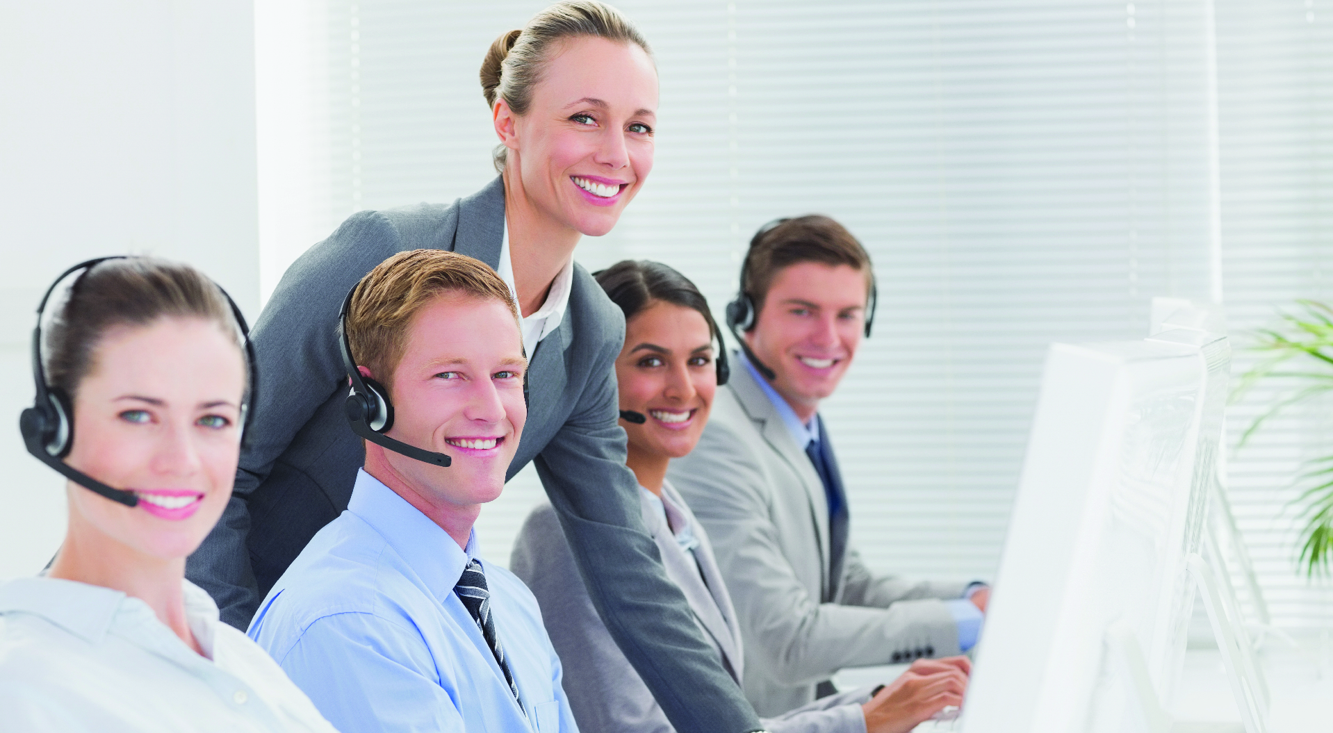 smiling people wearing call center headsets happy success story image